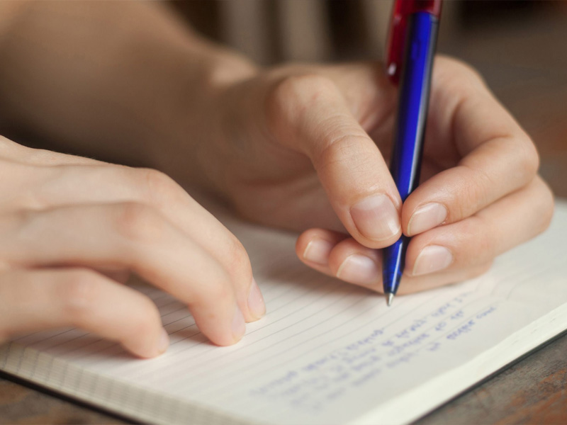 Girl Writing an Essay Outline